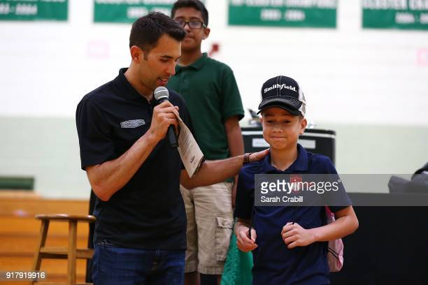 Aric Almirola driver of the Smithfield Ford Fusion for StewartHaas Racing in the Monster Energy NASCAR Cup Series visits honorroll students at Pierce...