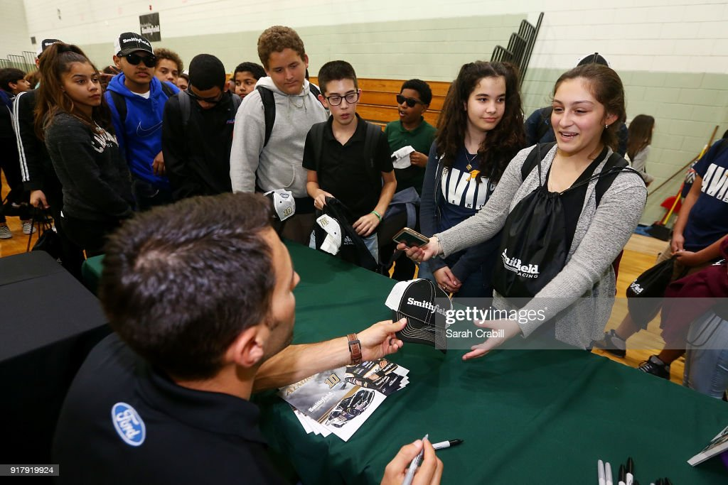 Aric Almirola, driver of the #10 Smithfield Ford Fusion for Stewart-Haas Racing in the Monster Energy NASCAR Cup Series, signs autographs for honor-roll students at Pierce Middle School on February 13, 2018 in Tampa, Florida.
