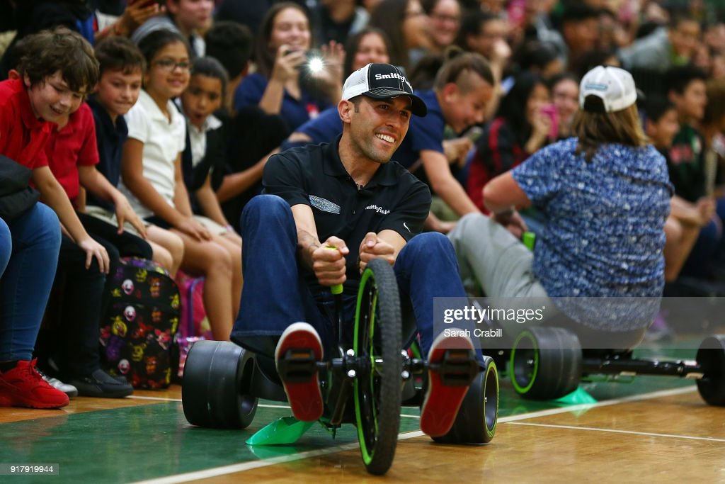 Aric Almirola, driver of the #10 Smithfield Ford Fusion for Stewart-Haas Racing in the Monster Energy NASCAR Cup Series, participates in a tricycle race with honor-roll students at Pierce Middle School on February 13, 2018 in Tampa, Florida.