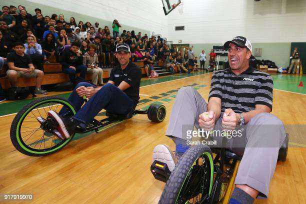 Aric Almirola driver of the Smithfield Ford Fusion for StewartHaas Racing in the Monster Energy NASCAR Cup Series participates in a tricycle race...