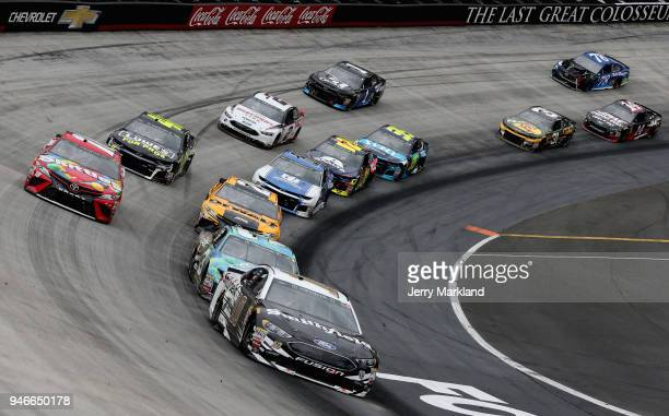 Aric Almirola driver of the Smithfield Ford leads a pack of cars during the Monster Energy NASCAR Cup Series Food City 500 at Bristol Motor Speedway...