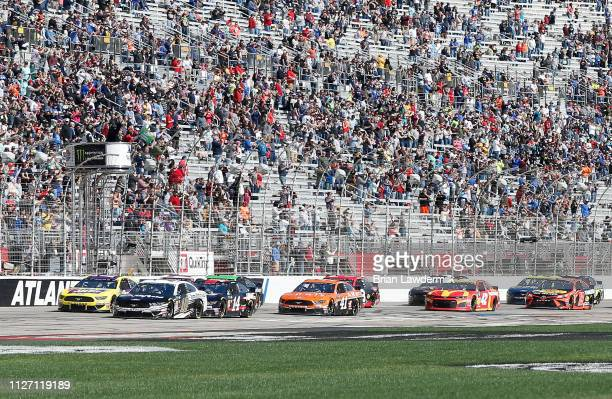 Aric Almirola driver of the Smithfield Ford leads the field to the green flag during the Monster Energy NASCAR Cup Series Folds of Honor QuikTrip 500...