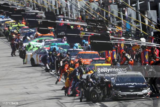 Aric Almirola, driver of the Smithfield Ford, pits during the Monster Energy NASCAR Cup Series Folds of Honor QuikTrip 500 at Atlanta Motor Speedway...