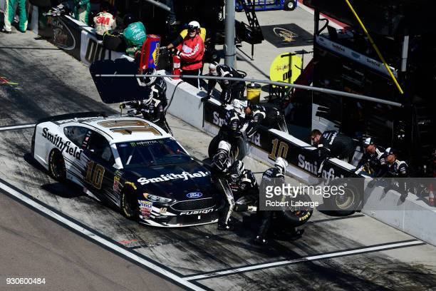 Aric Almirola driver of the Smithfield Ford pits during the Monster Energy NASCAR Cup Series TicketGuardian 500 at ISM Raceway on March 11 2018 in...