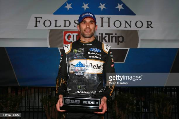 Aric Almirola driver of the Smithfield Ford poses for a photo after winning the pole award during qualifying for the Monster Energy NASCAR Cup Series...
