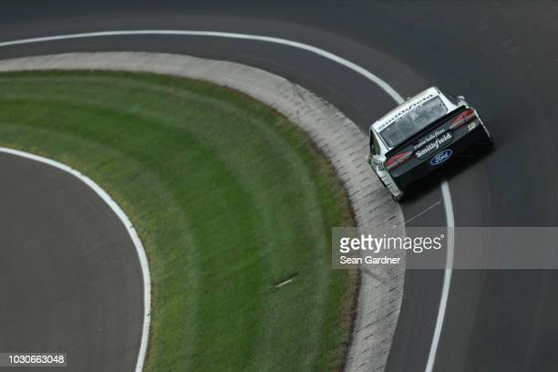 Aric Almirola driver of the Smithfield Ford races during the Monster Energy NASCAR Cup Series Big Machine Vodka 400 at the Brickyard at Indianapolis...