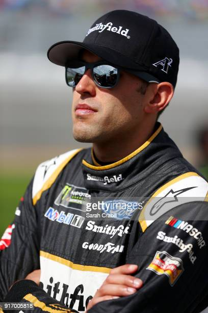 Aric Almirola driver of the Smithfield Ford stands on the grid during qualifying for the Monster Energy NASCAR Cup Series Daytona 500 at Daytona...