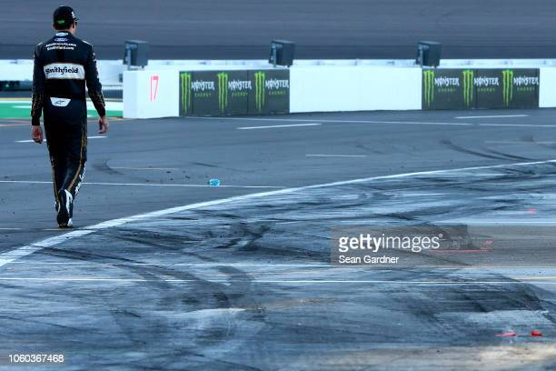 Aric Almirola driver of the Smithfield Ford walks down pit road following the Monster Energy NASCAR Cup Series CanAm 500 at ISM Raceway on November...
