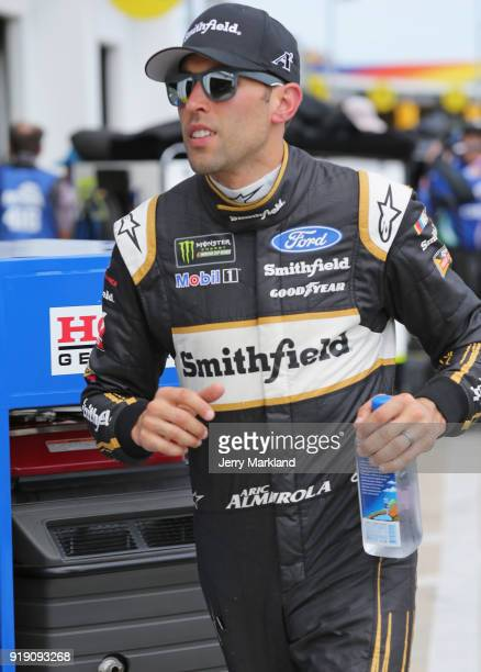 Aric Almirola driver of the Smithfield Ford walks to his car during practice for the Monster Energy NASCAR Cup Series Daytona 500 at Daytona...