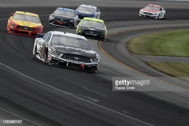 Aric Almirola, driver of the Smithfield Vote For Bacon Ford, leads the field during the NASCAR Cup Series Pocono Organics 325 in partnership with...