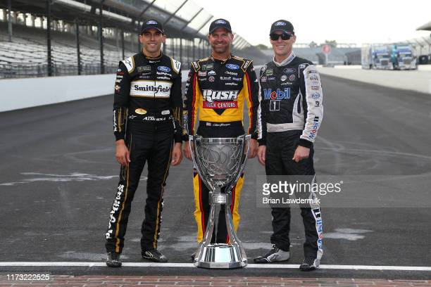 Aric Almirola driver of the Smithfield/Meijer Ford Clint Bowyer driver of the Rush/Cummins Ford and Kevin Harvick driver of the Mobil 1 Ford pose for...