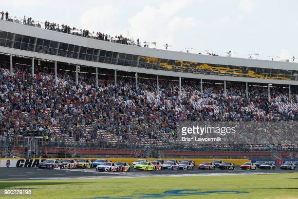 Aric Almirola driver of the Smithfield/Waffle House Ford leads the field to green for the start of the Monster Energy NASCAR Cup Series AllStar Race...