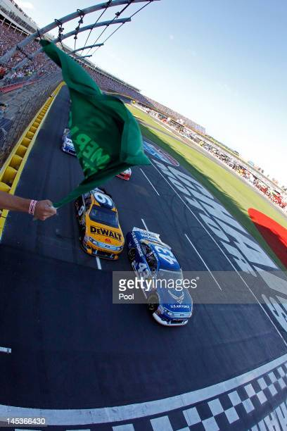 Aric Almirola, driver of the U.S. Air Force Ford, and Marcos Ambrose, driver of the DEWALT Ford, lead the field to the green flag to start the NASCAR...