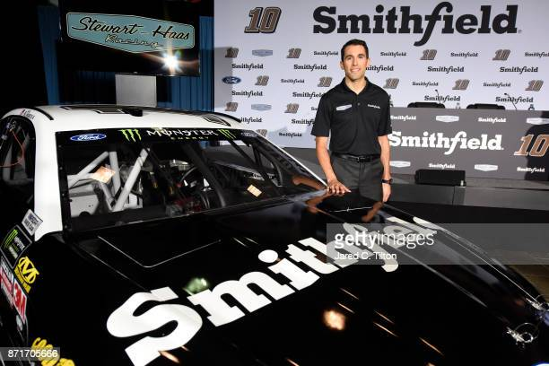 Aric Almirola poses for a photo opportunity with the Smithfield Ford during a press conference at StewartHaas Racing on November 8 2017 in Kannapolis...