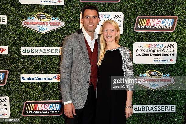 Aric Almirola poses with his wife Janice during the NASCAR Evening Series with Chef Daniel Boulud presented by Bank of America at db Brasserie at The...