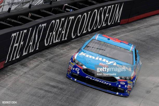 Aric Almirola Richard Petty Motorsports Ford Fusion drives through the middle of turns one and two during practice for the Bass Pro Shops NRA Night...