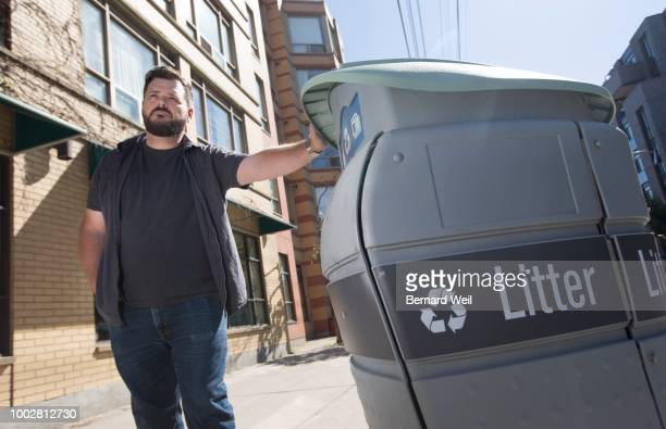 Aric Guite a Toronto resident who stands next to a garbage bin on the north east corner of Queen St and Pape Ave Guite using Twitter alerted the city...