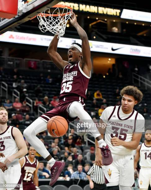 Aric Holman of the Mississippi State Bulldogs dunks the ball against the Arizona State Sun Devils during the second half of a semifinal game of the...