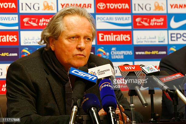 Arie Haan head coach of Tianjin Taida talks to the media during a press conference after the AFC Champions League Group E match between Tianjin Teda...