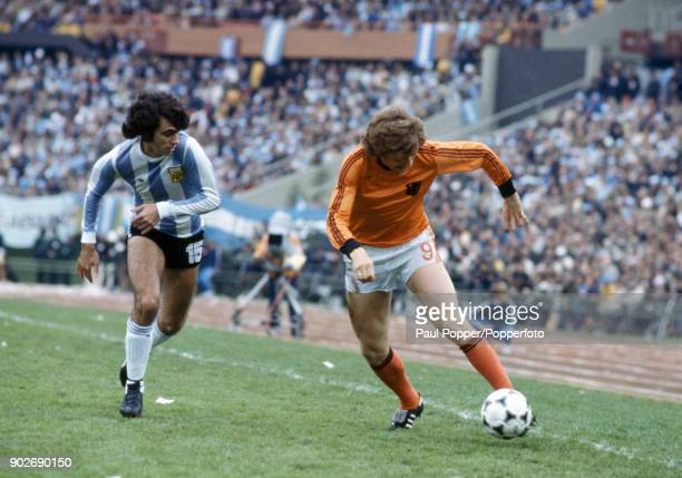 Arie Haan of Holland moves past Argentina's Jorge Olguin during the FIFA World Cup Final between Argentina and Holland at the Estadio Monumental in...