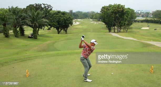 Arie Irawan of Malaysia hits his teeshot on the first hole on Day One of the Maybank Championship at Saujana Golf Country Club Palm Course on March...