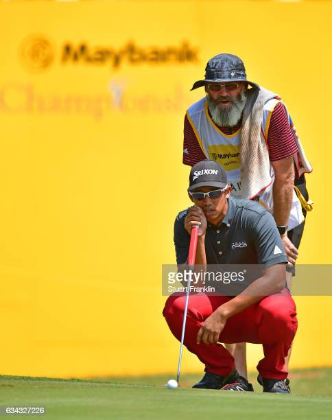 Arie Irawan of Malaysia lines up a putt during Day One of the Maybank Championship Malaysia at Saujana Golf Club on February 9 2017 in Kuala Lumpur...