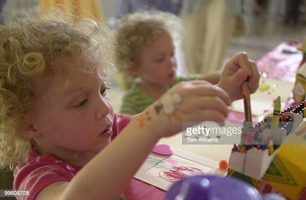 Arie Linz left and sister Mica make crafts at the opening of the PBS' new show 'Between the Lions' that encourages kids to read