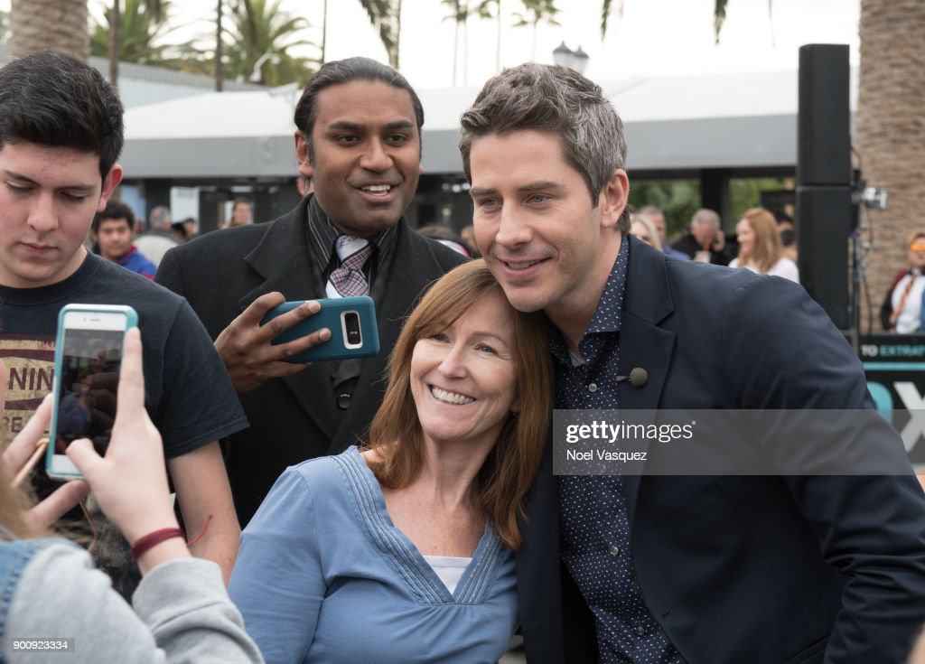 Arie Luyendyk takes a selfie with fans at 'Extra' at Universal Studios Hollywood on January 3, 2018 in Universal City, California.