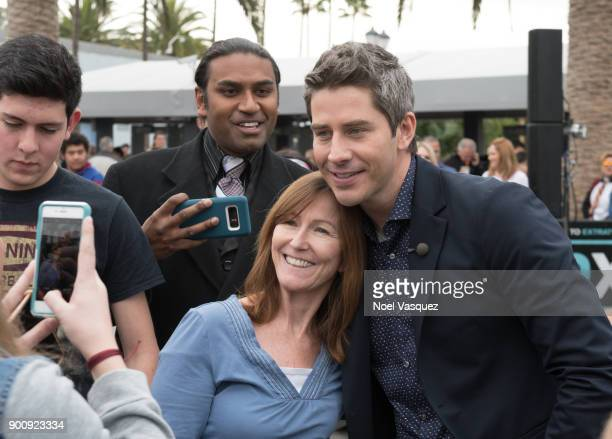 Arie Luyendyk takes a selfie with fans at 'Extra' at Universal Studios Hollywood on January 3 2018 in Universal City California