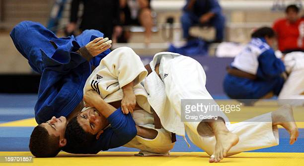 Ariel Alencar of Brazil competes against Nathan Bain of Australia in the Men's 60 kg division of the Judo event in the Sports Halls at Sydney Olympic...