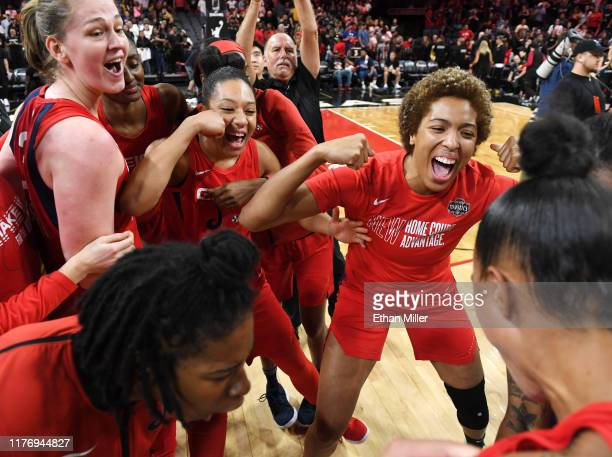 Ariel Atkins and Emma Meesseman Aerial Powers and Tianna Hawkins of the Washington Mystics celebrate on the court after their 9490 victory over the...