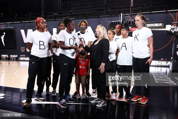 Ariel Atkins and members of the Washington Mystics talks with Holly Rowe of ESPN at Feld Entertainment Center on August 26, 2020 in Palmetto,...