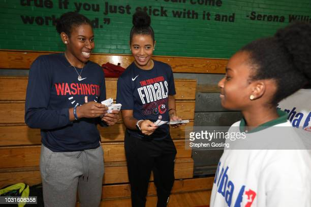 Ariel Atkins and Natasha Cloud of the Washington Mystics gives out tickets to participants during the 2018 Jr WNBA Clinic on September 11 2018 at...