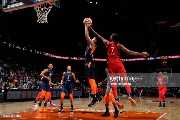 Ariel Atkins of the Washington Mystics blocks the ball against Courtney Williams of the Connecticut Sun on July 24 2018 at the Mohegan Sun Arena in...