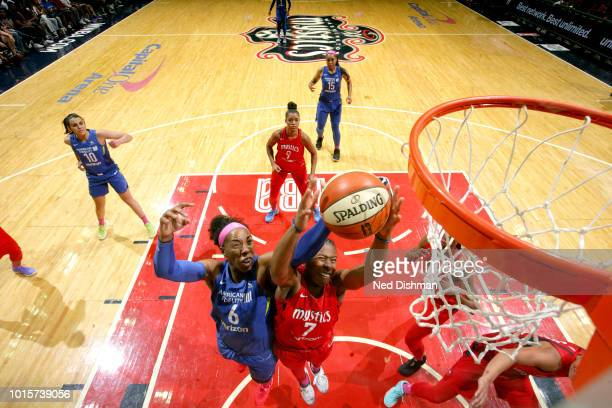 Ariel Atkins of the Washington Mystics gets the rebound against Kayla Thornton of the Dallas Wings on August 12 2018 at the Capital One Arena in...