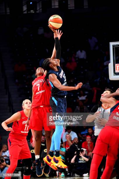 Ariel Atkins of the Washington Mystics goes against Tiffany Hayes of the Atlanta Dream for jump ball during Game Five of the 2018 WNBA Semifinals on...