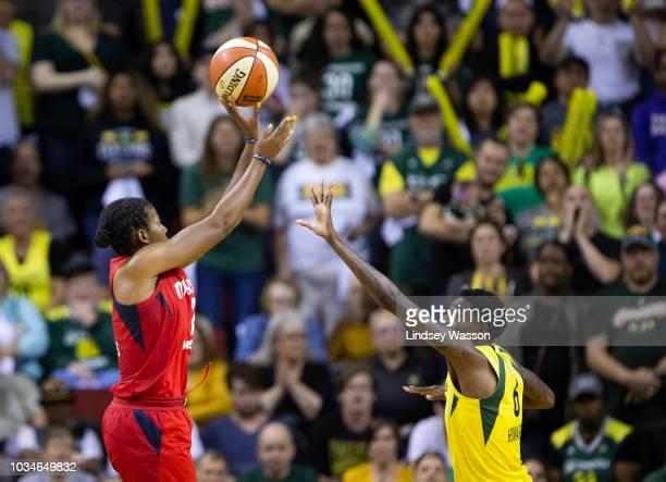Ariel Atkins of the Washington Mystics sends a shot over Natasha Howard of the Seattle Storm during the second half of Game 2 of the WNBA Finals at...