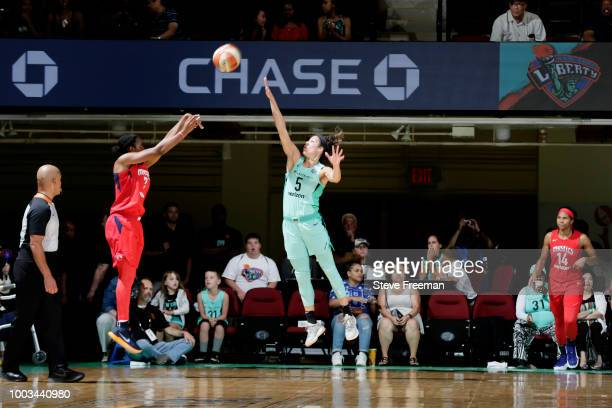Ariel Atkins of the Washington Mystics shoots the ball against Kia Nurse of the New York Liberty during the game on July 21 2018 at Westchester...