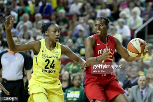Ariel Atkins of the Washington Mystics works against Jewell Loyd of the Seattle Storm in the third quarter during game one of the WNBA Finals at...