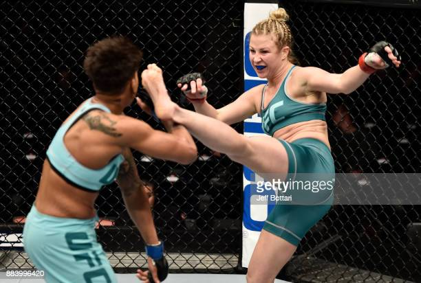 Ariel Beck kicks Shana Dobson in their women's flyweight bout during the TUF Finale event inside Park Theater on December 01 2017 in Las Vegas Nevada