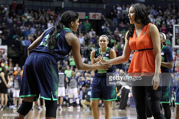 Ariel Braker of the Notre Dame Fighting Irish shakes hands with injured teammate Natalie Achonwa prior to their NCAA Women's Final Four Championship...