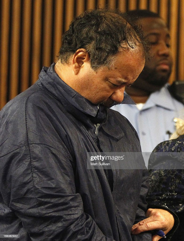Ariel Castro stands with his head down during his arraignment on kidnapping and rape charges on May 9, 2013 in Cleveland, Ohio. Castro is accused of abducting three girls, Michelle Knight, 32, Amanda Berry, 27 and Gina DeJesus, believed to be about 23 and holding them for about 10-years.