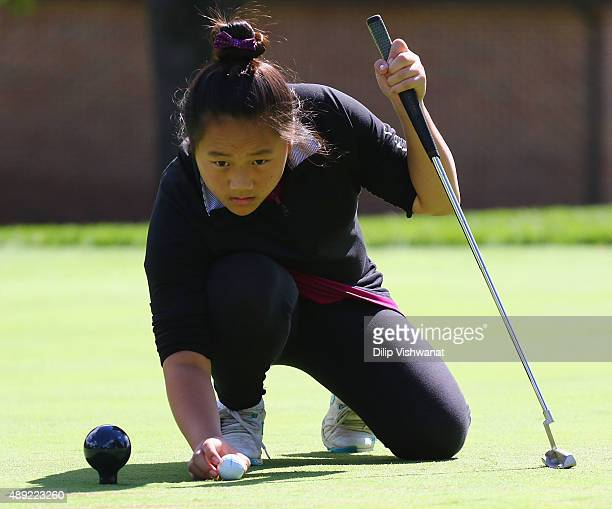 Ariel Chang lines up her putt in the girls 1213 putting section during the 2015 Drive Chip and Putt Tournament at Medinah Country Club on September...