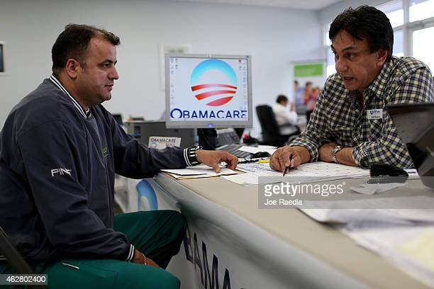 Ariel Fernandez sits with Noel Nogues, an insurance advisor with UniVista Insurance company, as he signs up for the Affordable Care Act, also known...