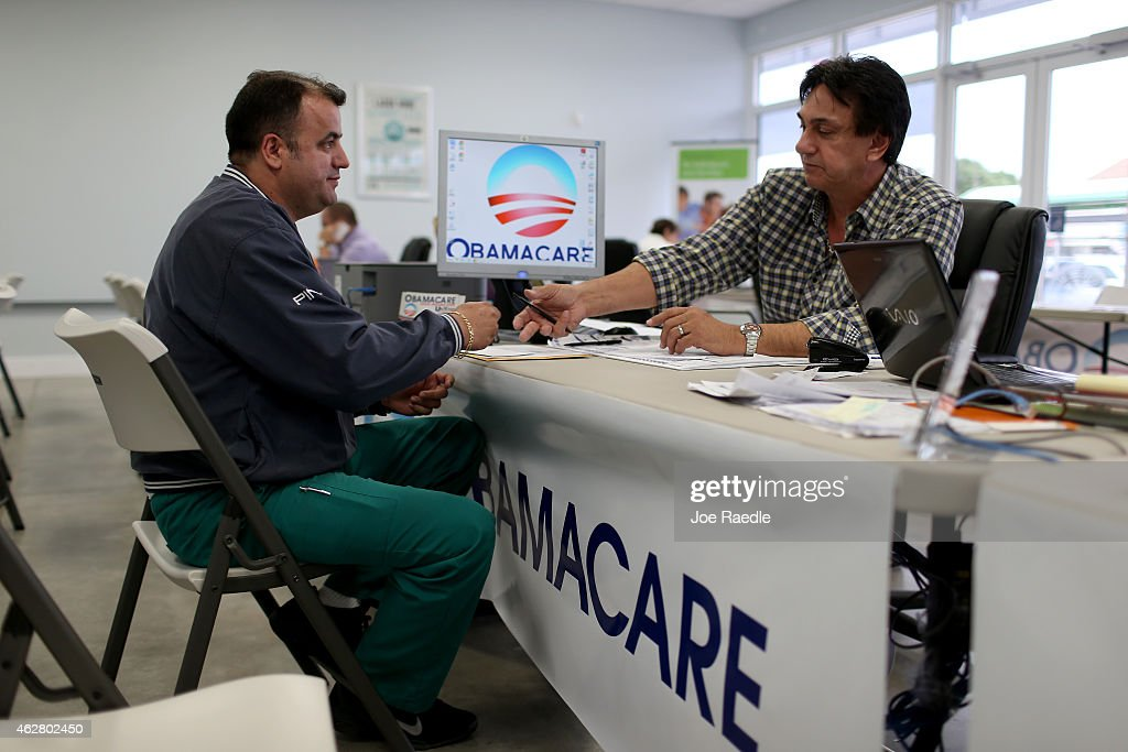 Ariel Fernandez (L) sits with Noel Nogues, an insurance advisor with UniVista Insurance company, as he signs up for the Affordable Care Act, also known as Obamacare, before the February 15th deadline on February 5, 2015 in Miami, Florida. Numbers released by the government show that the Miami-Fort Lauderdale-West Palm Beach metropolitan area has signed up 637,514 consumers so far since open enrollment began on Nov. 15, which is more than twice as many as the next large metropolitan area, Atlanta, Georgia.