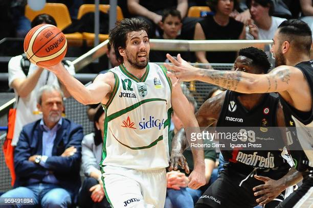Ariel Filloy of Sidigas competes with Jamil Wilson and Pietro Aradori of Segafredo during the LBA LegaBasket match between Virtus Segafredo Bologna...