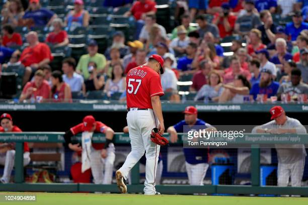 Ariel Jurado of the Texas Rangers walks to the dugout after being pulled from the game against the Los Angeles Dodgers in the top of the third inning...