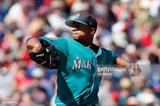 Ariel Miranda of the Seattle Mariners pitches in the first inning against the Los Angeles Angels of Anaheim during a spring training game at Tempe...