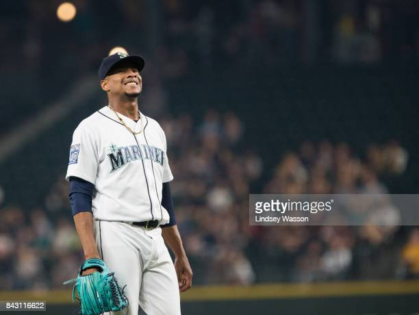 Ariel Miranda of the Seattle Mariners winces after walking George Springer of the Houston Astros in the third inning at Safeco Field on September 5...