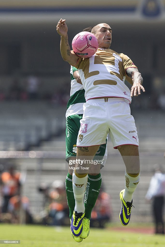 Ariel Nahualpan of Pumas fights for the ball during a match between Pumas and Santos as part of the Apertura 2013 Liga MX at Olympic Stadium on October 06, 2013 in Mexico City, Mexico.